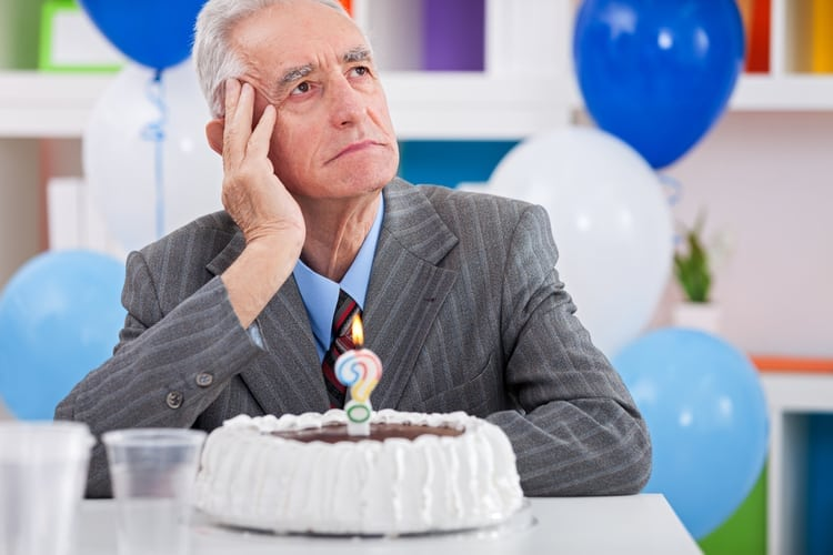 Senior man sitting front of cake birthday ask yourself how old am I