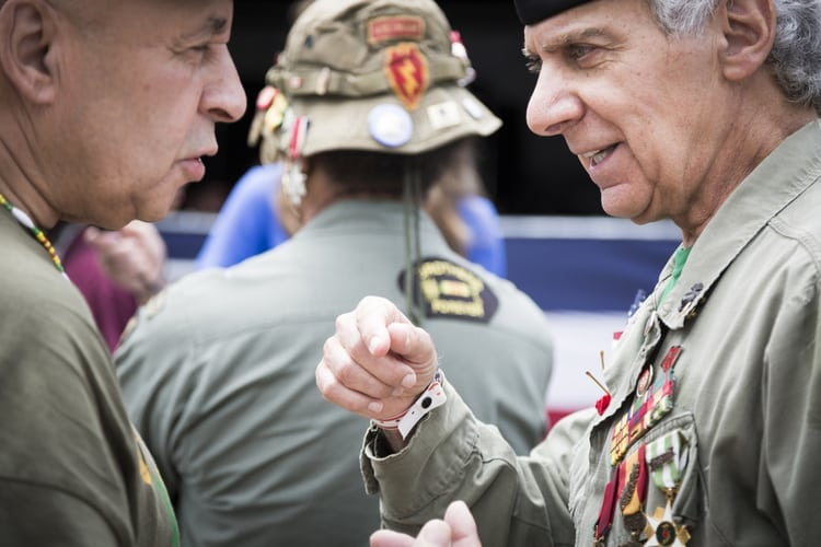 US veterans in their uniforms with medals reunite