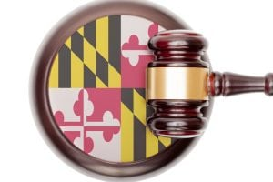 Wooden judge gavel with Maryland State Flag