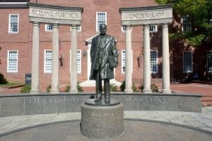 US Supreme Court justice Thurgood Marshall statue with Equal Justice Under Law inscription on monument