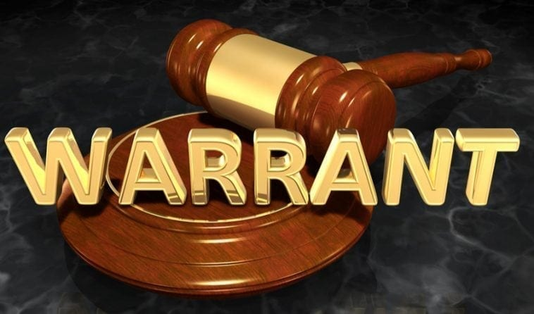 Gavel with the word Warrant written on it