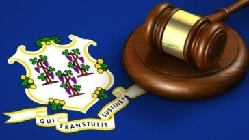 Connecticut US state law, legal system and justice concept with a gavel on the Connecticutian flag on background