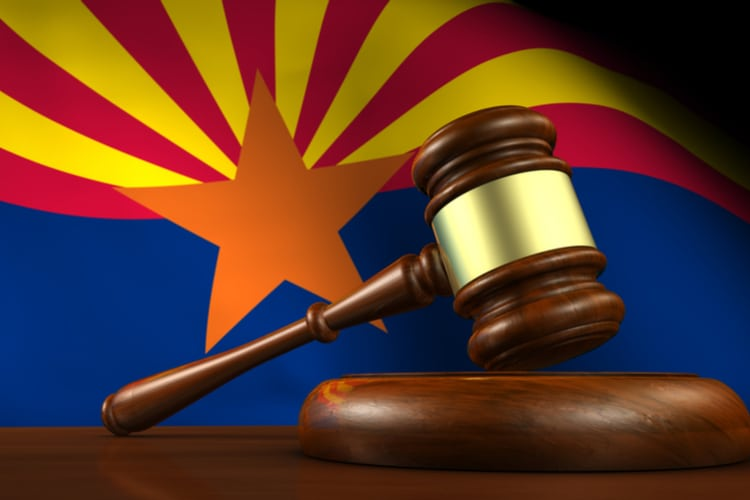 Arizona US state laws, legal system and justice concept with a 3D rendering of a gavel and the Arizonan flag on background